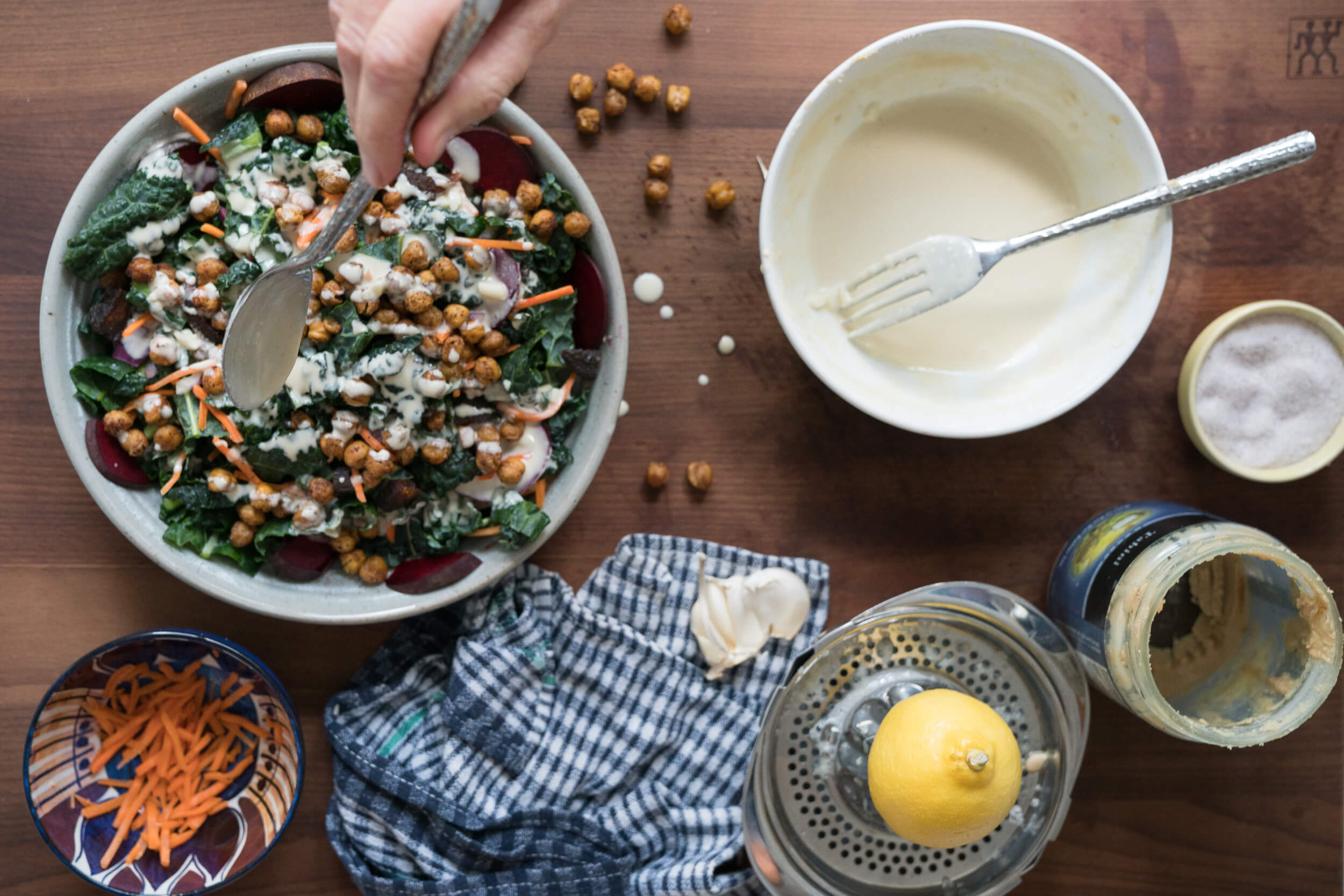 Roasted Chickpea and Kale Salad being dressed