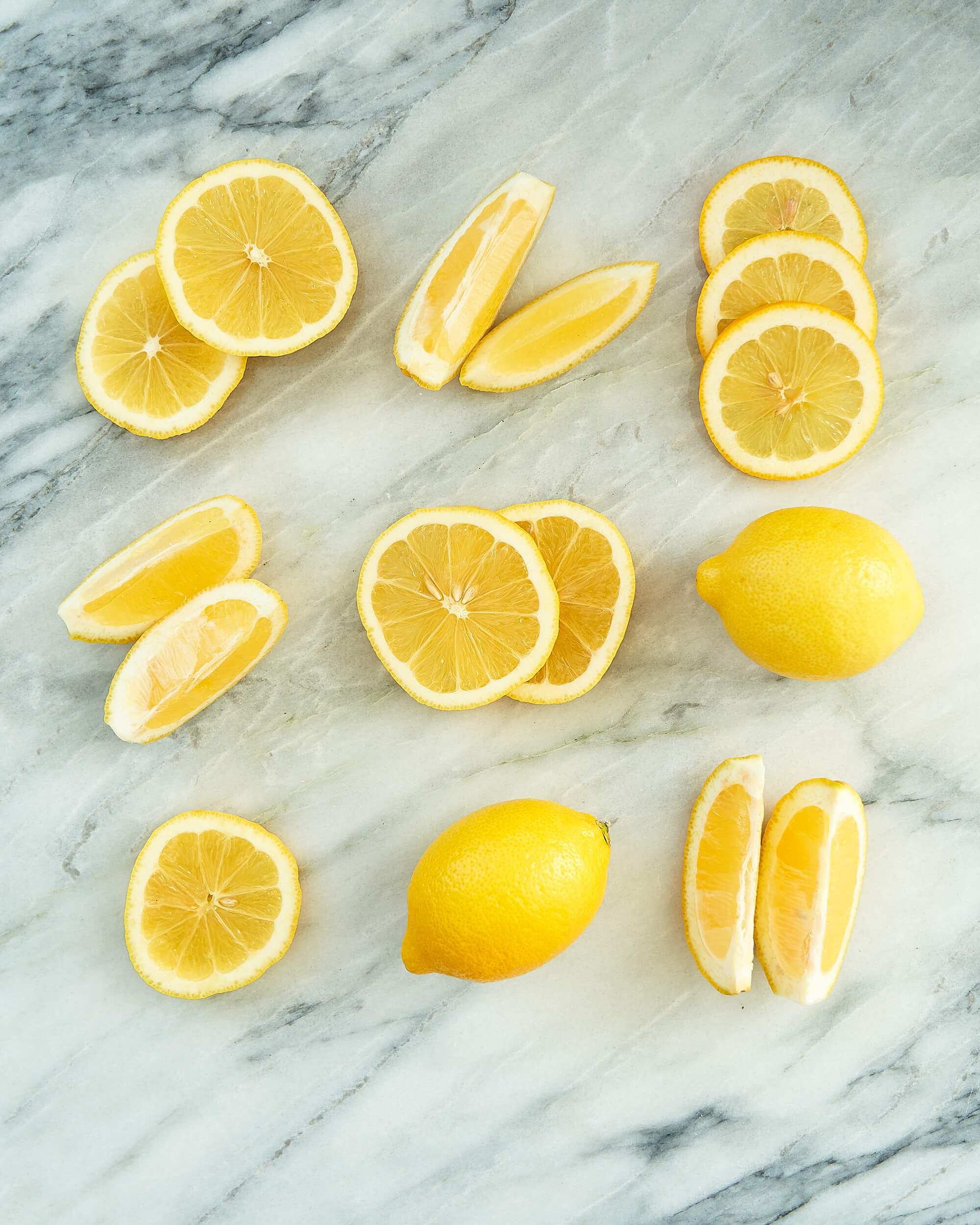 Lemons cut and displayed on a marble counter