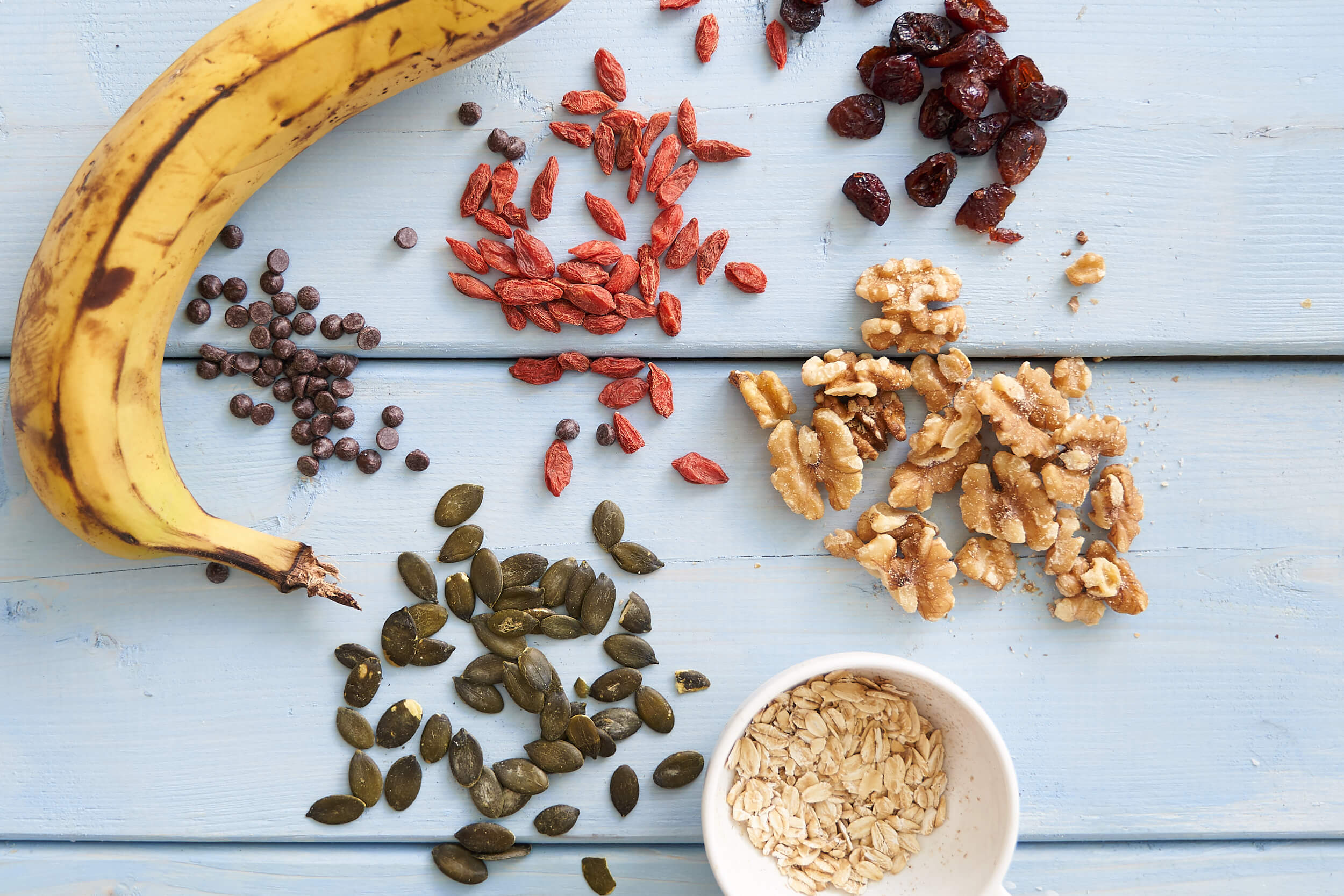 chocolate chips goji berries walnuts pumpkin seeds and banana for granola bars