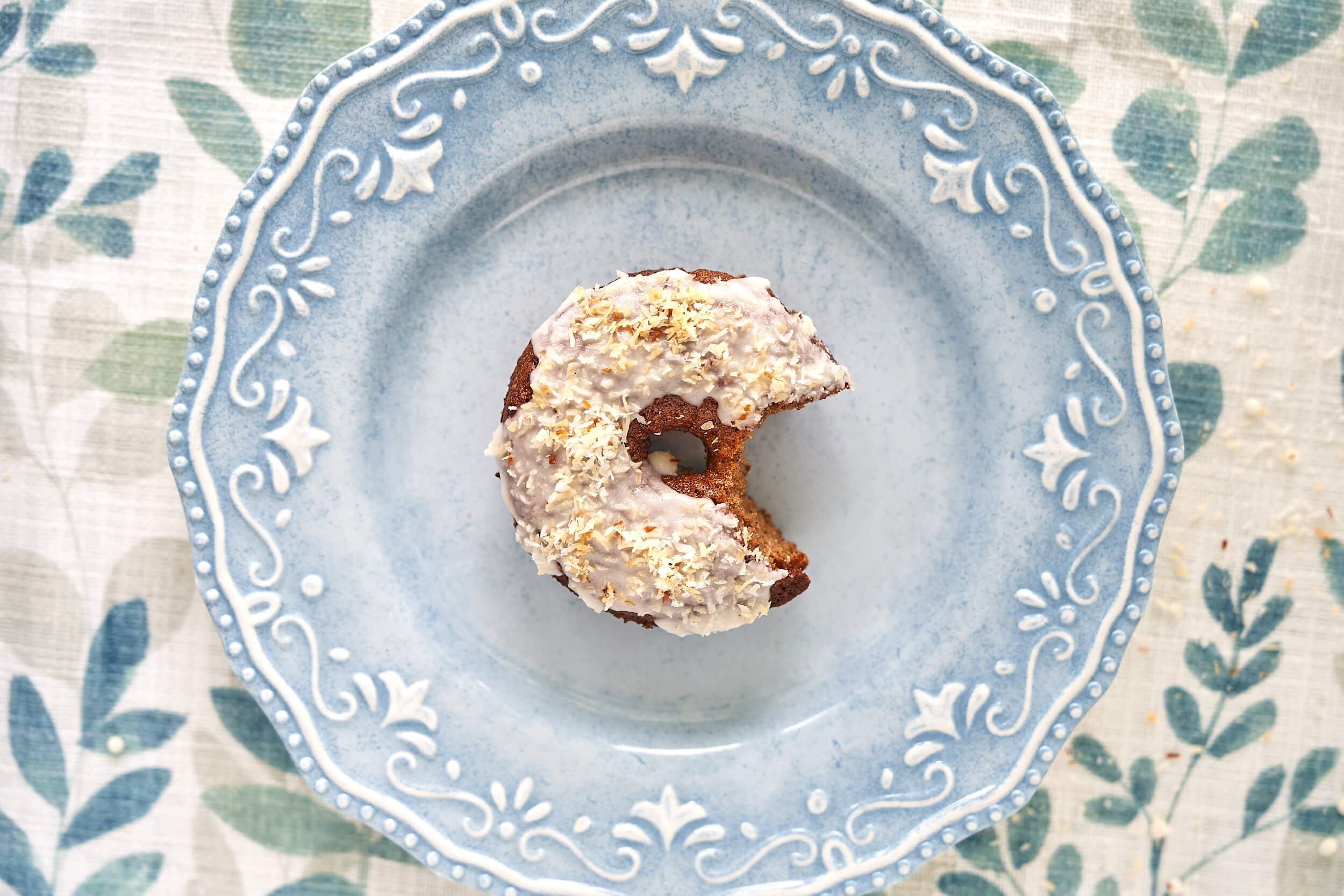 Gluten-free donut on a blue plate.